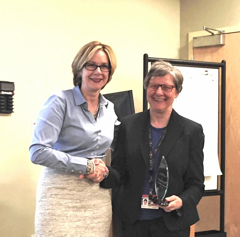 Sharon-Lise Normand, left, accepts award from L. Adrienne Cupples, Harvard SPH professor of biostatistics.